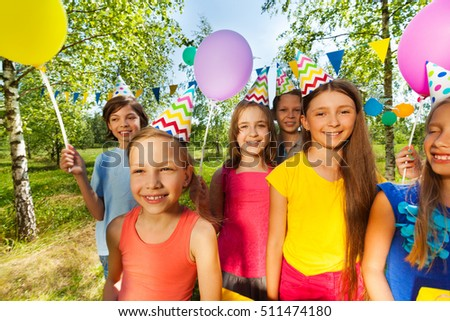 Smiling kids in party hats celebrating birthday #511474180