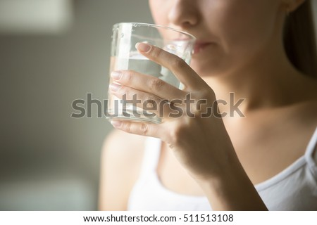 Female drinking from a glass of water. Health care concept photo, lifestyle, close up #511513108