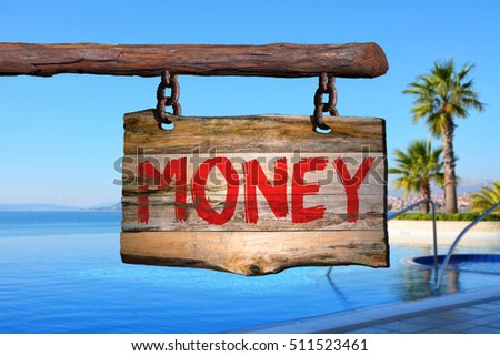 Money motivational phrase sign on old wood with blurred background #511523461