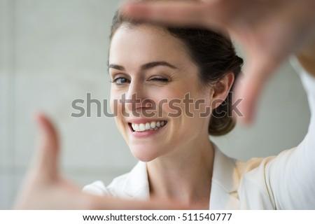 Closeup of Smiling Woman Making Frame Gesture #511540777