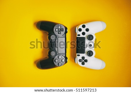 Computer gaming competition. Gaming concept. White and black joystick on yellow background. #511597213