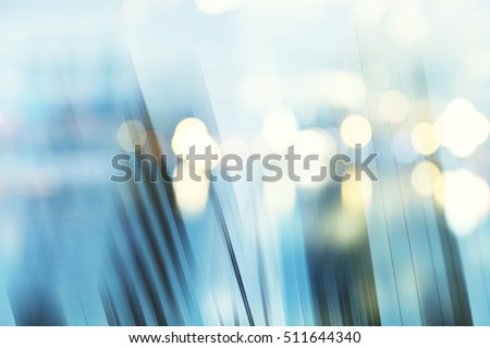 Abstract business modern city urban futuristic architecture background. Real estate concept, motion blur, reflection in glass of high rise skyscraper facade, toned blue picture with bokeh #511644340