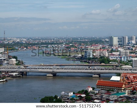 BANGPO, BANGKOK, THAILAND - SEPTEMBER 23, 2016: View of Chao Phraya River from a high rise building. This is the major river of Thailand that flows through Bangkok and then into the Gulf of Thailand. #511752745