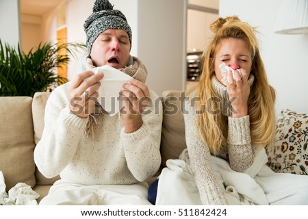 Sick couple catch cold. Man and woman sneezing, coughing. People got flu, having runny nose.  Royalty-Free Stock Photo #511842424