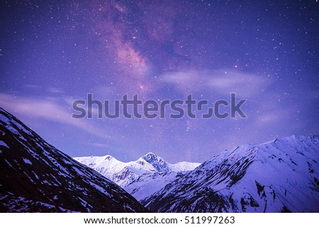Milky Way over the mountains of the Himalayas at the time of the transition from night to sunrise. Annapurna III (7555 m) peak. #511997263