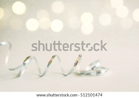 Abstract image of christmas festive ribbon decoration with glitter background