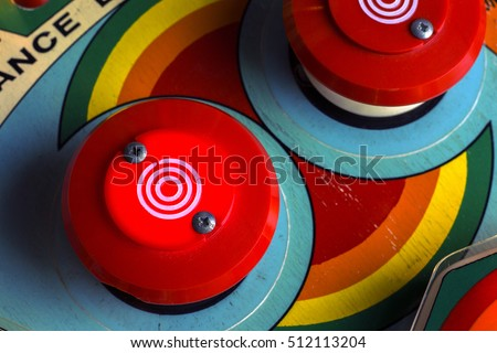Red bumpers on a retro pinball machine Royalty-Free Stock Photo #512113204