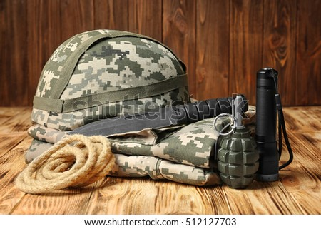 Set of military outfit on wooden background, close up #512127703