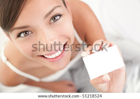 Casual business card woman. High angle view of beautiful mixed race Asian Chinese / Caucasian young woman.
