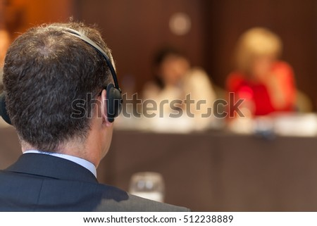 man with headset at the conference Royalty-Free Stock Photo #512238889