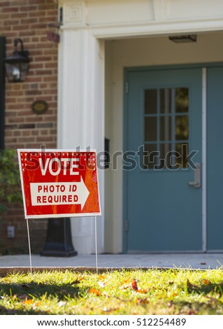 ARLINGTON, VIRGINIA, USA - NOVEMBER 8, 2016: Vote sign on presidential election day. Photo ID Required in Virginia. #512254489