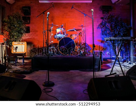 Rock concert stage with musical instruments in nightclub Royalty-Free Stock Photo #512294953