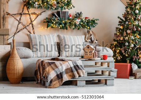 Calm image of interior modern home living room decorated christmas tree and gifts, sofa, table covered with blanket. #512301064