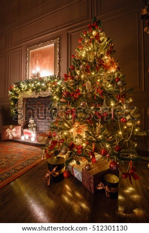 Calm image of interior Classic New Year Tree decorated in a room with fireplace #512301130