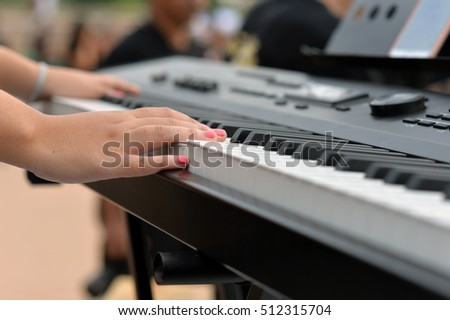 Close up of musician playing electone #512315704
