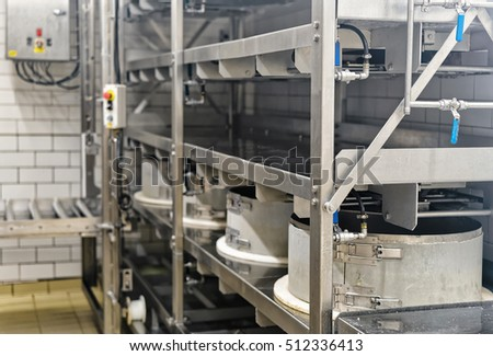 Automated equipment for the production of Gruyere de Comte Cheese in Franche Comte creamery, Burgundy, in France. #512336413