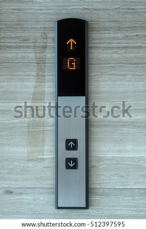 Elevator Button up and down direction with down up light on granite background
