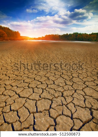 Land with dry and cracked ground. Climate change, drought, cracked ground #512500873
