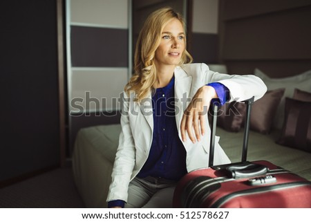 Beautiful traveling woman staying in hotel room #512578627