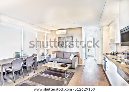 Kitchen interior with sofa set and ceramics, luxury room with brown  dining table and sofa, wash basin and gas cooker have attached to the wall, lamp table near the sofa. #512629159