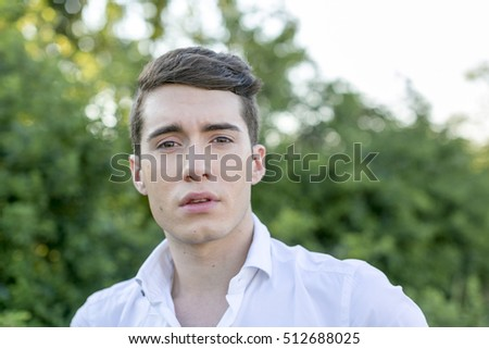 portrait of young man at sunset #512688025
