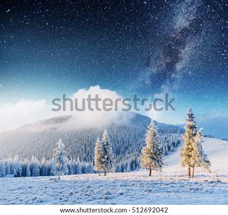 fantastic winter meteor shower and the snow-capped mountains #512692042