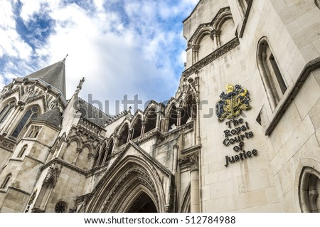 The Victorian Gothic style main entrance to the The Royal Courts of Justice public building in London, UK, opened in 1882 Royalty-Free Stock Photo #512784988