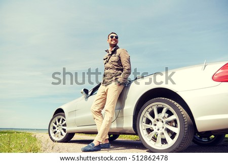 road trip, travel, transport, leisure and people concept - happy man near cabriolet car outdoors #512862478