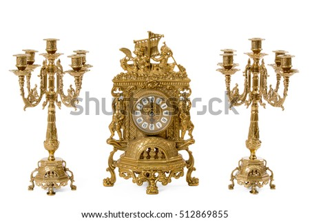 Two vintage gold candle holder and clock on a white background #512869855