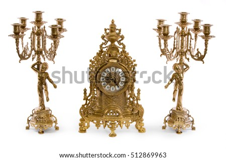 Two vintage gold candle holder and clock on a white background #512869963