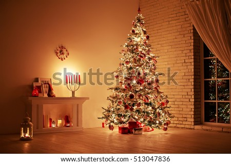 Feast of the Nativity. Beautifully decorated house with a tree and presents at Christmas #513047836
