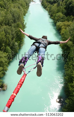 Bungee jumping over beautiful river #513063202