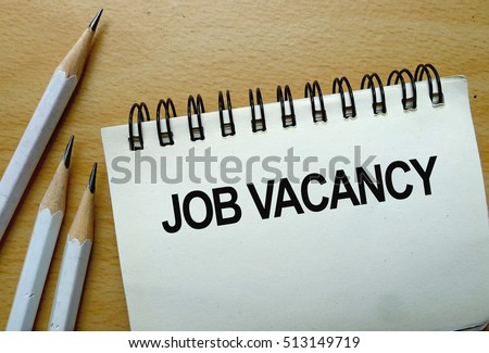 Job Vacancy text written on a notebook with pencils Royalty-Free Stock Photo #513149719