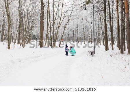 Happy family. Mother and child girl on a winter walk in nature. #513181816