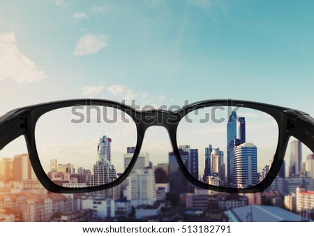 Eye glasses looking to city view, focused on glasses lens #513182791