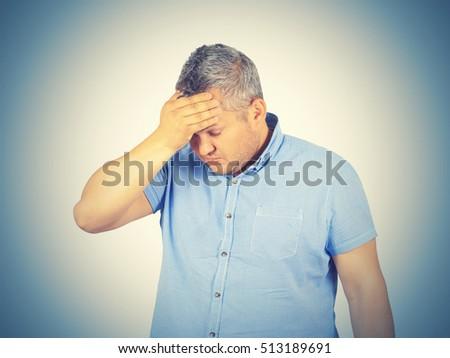 Businessman desperate, depressed, headache. Isolated on background.  #513189691