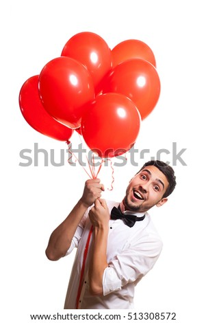 young handsome man in white shirt flying on red balloons on white background, Concept holidays
