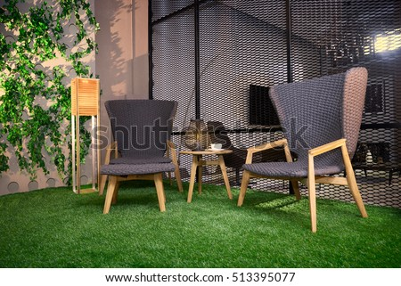 two comfortable chairs on the grass #513395077