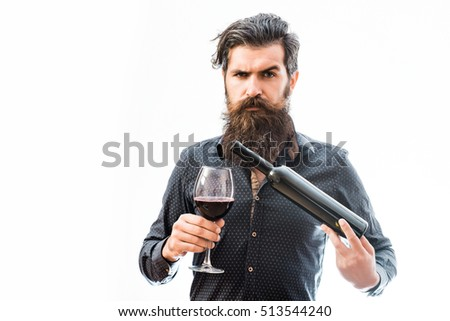 handsome bearded rich man with stylish hair mustache and long beard on serious face in blue fashion shirt holding glass of red wine and bottle isolated on white #513544240