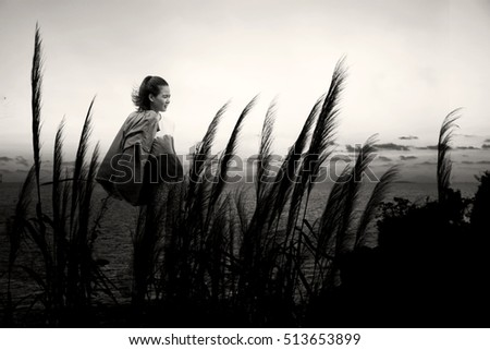The girl walks by the sea in sunset sky,relax in nature background #513653899
