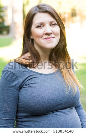Young happy pregnant woman relaxing  #513854140