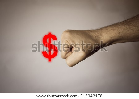 Human hand on vintage background to express strength against dollar #513942178