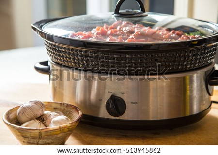 preparing ahead of time makes hearty slow cooker meals are a favorite for fall and winter cooking Royalty-Free Stock Photo #513945862