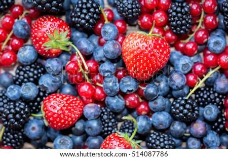 Berries variety - berries background: strawberries, currants; blueberries, blackberries #514087786
