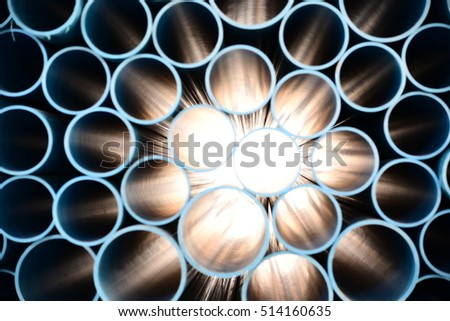 PVC pipe overlapping layers. #514160635