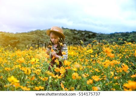 Little asian girl in flower fields, Outdoor portrait #514175737