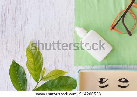 Close up cleaning glasses by microfiber cloth for cleaning lens and glasses concept.Close up cleaning glasses by microfiber cloth on white wood table.cleaning concept. #514200553