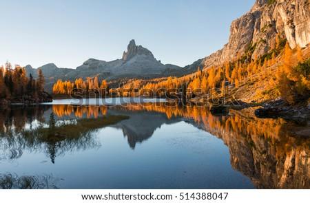 Amazing autumn scenery in the Dolomites mountains at Lake Federa. #514388047