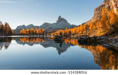 Amazing autumn scenery in the Dolomites mountains at Lake Federa. #514388056