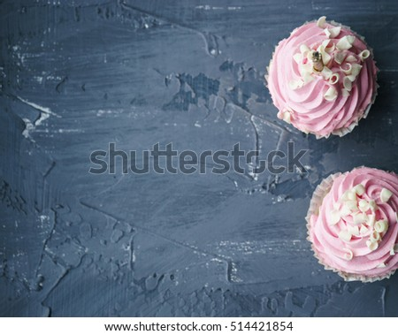 image of sweet cupcakes on gray table